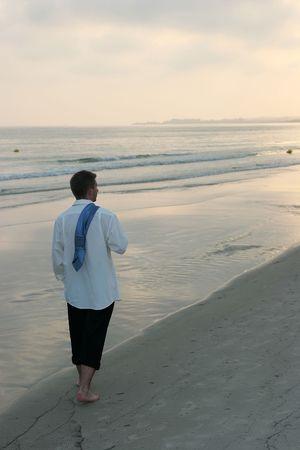 Businessman at the beach photo