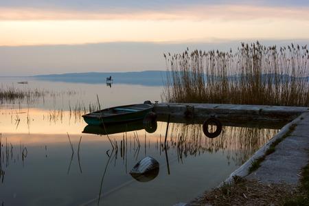 balaton: The boat docked on the lake Balaton at sunset