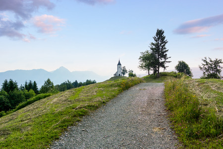 primus: Jamnik church on a hillside in the summer morning, in Slovenia, Europe. Stock Photo