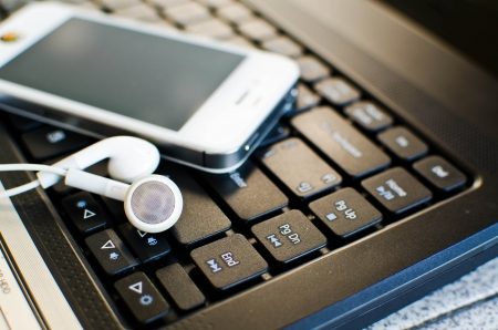 Music digital black laptop and white earphone photo
