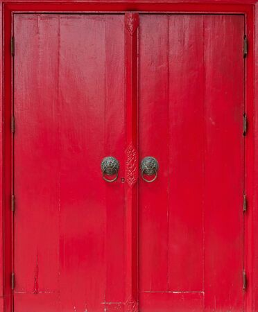 an old wood door red color with metal handle photo