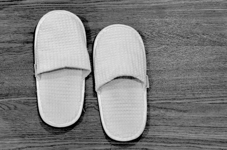 slippers in the bathroom, black & white style. photo