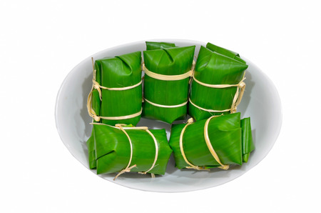Bunch of rice in Thailand Thai dessert made from banana and glutinous rice, wrap with banana leaf  photo