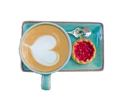 Cup of coffee, heart shape with strawberry biscuit on white photo