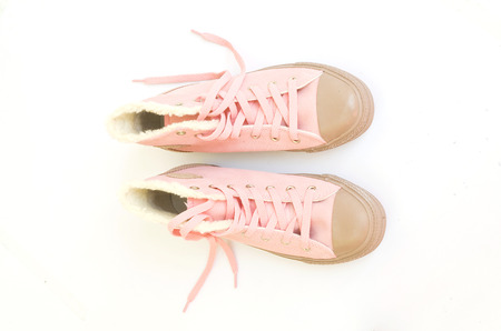 pink sneakers on white background photo