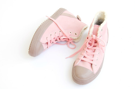 pink and brown sneakers on white background. photo