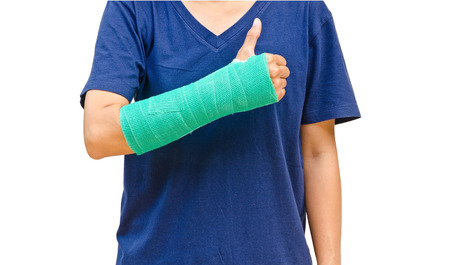 Green cast on hand and arm on white background.