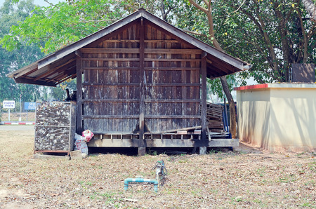 LAMPHUN, THAILAND – MARCH 14:Old wooden house for storage waste to recycling at Ban  Nam-Phu. March 14, 2014.