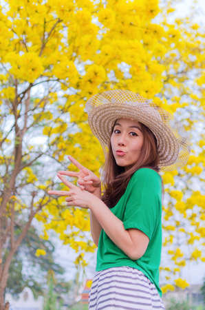 beautiful woman long hair with yellow flowers, outdoor portrait. photo