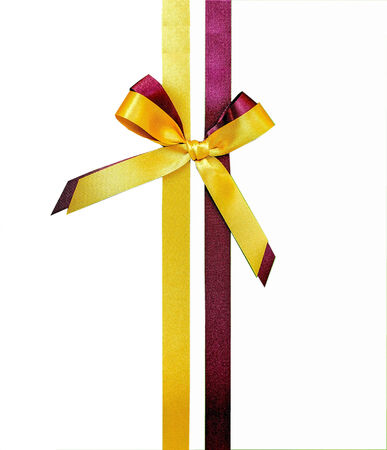 yellow ribbon: Yellow and brown satin ribbon isolated.