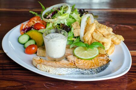 grilled Salmon with Fresh Salad Leaf photo