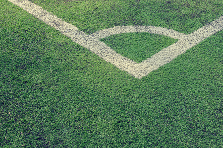 turf: Artificial turf soccer field, a corner marker line