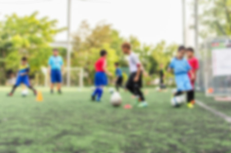 Kid soccer player in academy Stock Photo