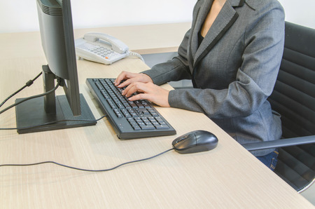 businesswoman typing on black computer keyboard