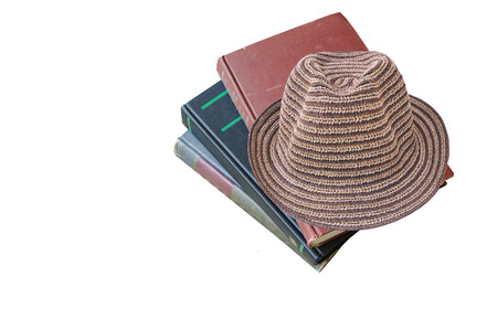shortsightedness: brown hat on old books isolated on white background Stock Photo