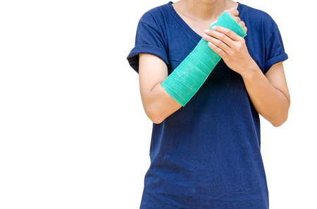 fractured: broken arm with green cast isolated on white