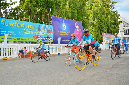 simultaneous: Lamphun,THAILAND, AUG 16-2015 : This event is Bike for mom  from Thailand. Bike for mom event show respected to Queen and make Thailands cyclists set record for worlds biggest bike ride Editorial
