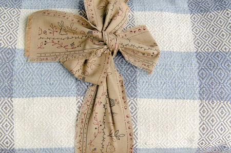 rolled: Cotton blanket rolled on wood background