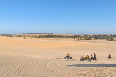 ne: white sand dune desert and lake in Mui Ne, Vietnam.