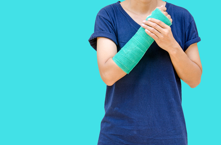 green cast on hand and arm isolated on blue background.