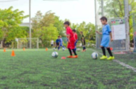 academy: blurred background kid soccer player in academy.