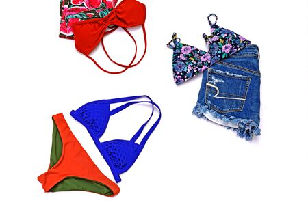 bikini top: Travel accessories costumes, summer vacation background, bikini and short jean woman clothes  on white background. Stock Photo