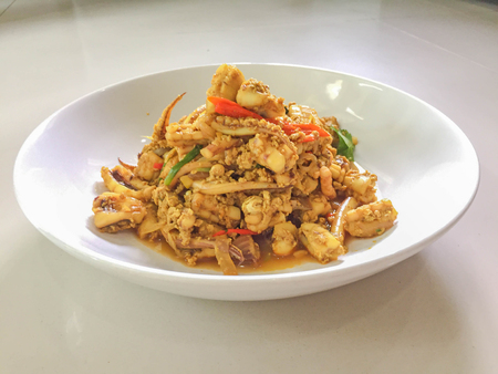 fried squid with curry power, Real traditional Thai food, One of favorite seafood menu Stock Photo