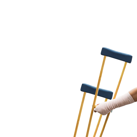 Body injury concept, arm pain and broken with wooden crutches isolated on white Stock Photo