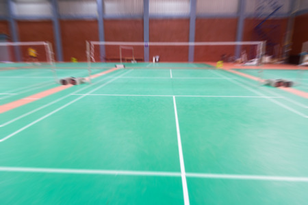 badminton court with blurred background woman playing badminton Stock Photo