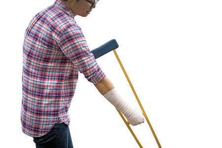 woman using crutches for patient broken leg isolated on white, clipping path included.