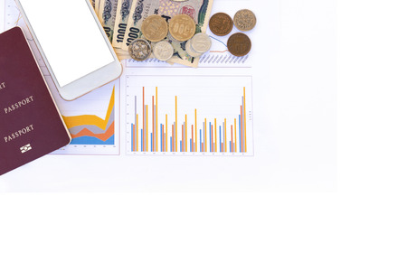 Japanese currency yen bank notes, yen coin, phone and passport on business graph data background