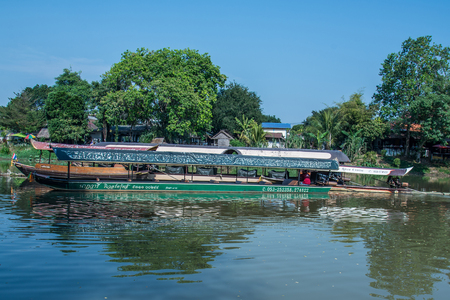 CHIANG MAI, THAILAND - FEBRUARY 18: river boat cruise for rent waiting for tourists to experience the atmosphere of the Ping River in Chiang Mai. It is a charming place in the north of Thailand.