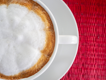 hot cappuccino coffee in white cup. Standard-Bild - 110095354