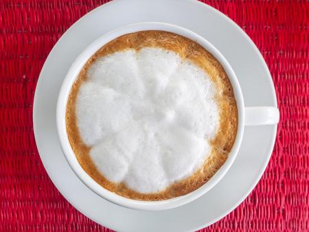 hot cappuccino coffee in white cup. Standard-Bild - 110095358