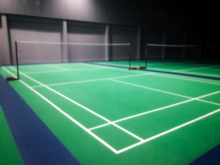 line on green badminton court
