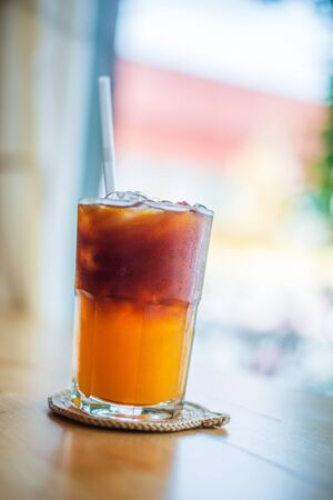Ice coffee, americano coffee with orange in cafe
