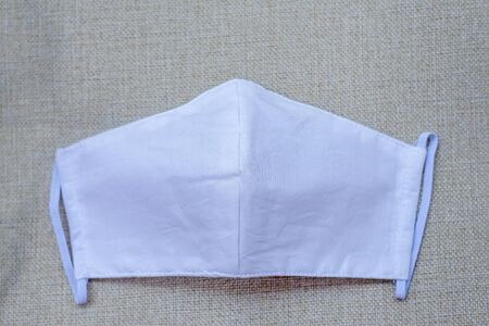 White cloth mask made from muslin cotton. Standard-Bild