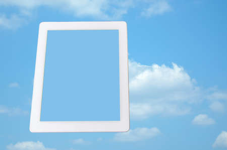 Tablet computer with blue sky on screen