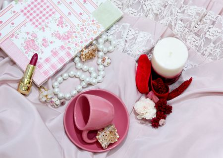 Gentle pink background with floral notebook and accessories Stock Photo - 4995006