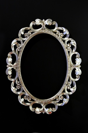 Antique oval silver frame with floral ornaments photo