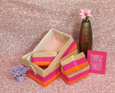 Assortment of colorful rattan baskets with pink flower Stock Photo - 12120355