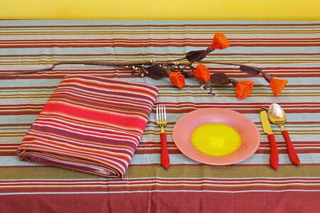Domestic home table setting with plate and utensils Stock Photo - 12120359