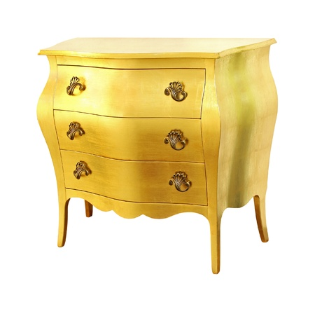 Gold chest of drawers isolated with clipping path included photo