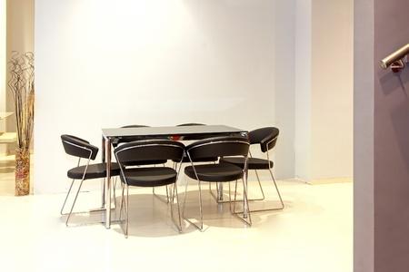 Modern minimalistic dinning table in modern interior Stock Photo