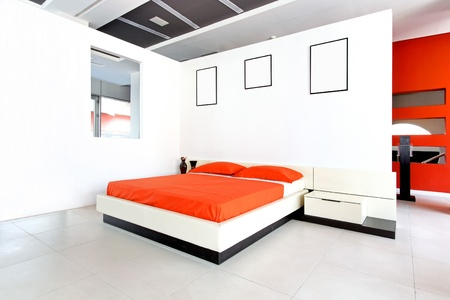 Modern bedroom interior with white walls and minimalistic furniture Stok Fotoğraf - 12152343