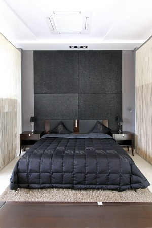Modern small bedroom interior with large double bed Stok Fotoğraf - 12149719