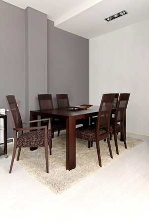 Classic wooden dinning table in modern interior photo