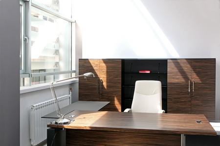 Modern home office interior wih wooden furniture photo