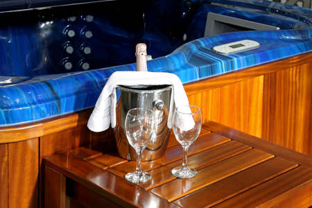 hydromassage: Champagne in ice bucket near hydromassage tub Stock Photo