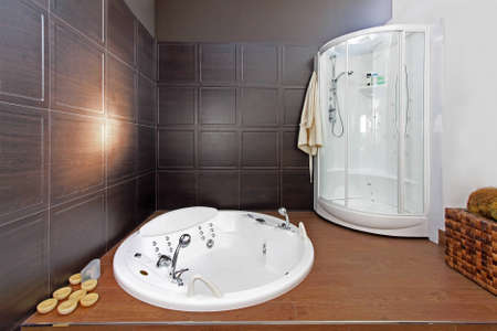 Modern bathroom interior with hydromassage bathtub and shower photo